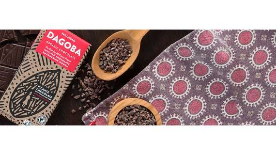 DAGOBA wrapped Picante Chocolate bar with wooden spoonful of cacao nibs